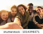 cheerful friends taking selfie... | Shutterstock . vector #1014398371