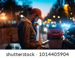 young hipster guy using modern... | Shutterstock . vector #1014405904