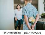 son giving mom flowers for... | Shutterstock . vector #1014409201