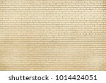 old beige brick wall background ... | Shutterstock . vector #1014424051