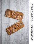 italian pizza on the wooden... | Shutterstock . vector #1014425419