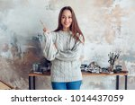 young woman artist painting at... | Shutterstock . vector #1014437059