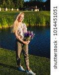 beautiful blonde woman wearing... | Shutterstock . vector #1014451051