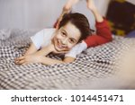 funny boy is lying on the sofa... | Shutterstock . vector #1014451471