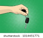 hand with a car key. vector... | Shutterstock .eps vector #1014451771