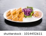 fried tofu served with sweet... | Shutterstock . vector #1014452611