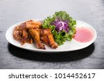 fried chicken wings served with ... | Shutterstock . vector #1014452617