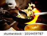 close up shot of a chef in a... | Shutterstock . vector #1014459787