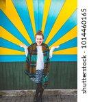 beautiful young woman shining... | Shutterstock . vector #1014460165