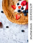overhead stack of thin pancakes ... | Shutterstock . vector #1014532129