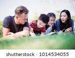 a boy determine writing cartoon ... | Shutterstock . vector #1014534055