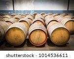wine barrels in the cellar of... | Shutterstock . vector #1014536611