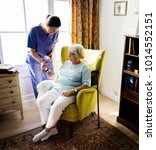 nurse is taking care of a... | Shutterstock . vector #1014552151