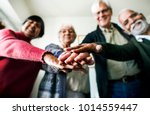 group of senior friends support ... | Shutterstock . vector #1014559447