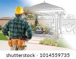 contractor standing looking at... | Shutterstock . vector #1014559735
