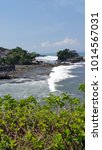 Small photo of scenic view of tanah lot accentuated by white waves