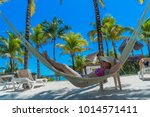 woman relaxing in a hammock | Shutterstock . vector #1014571411