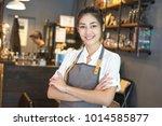 asian barista woman standing...   Shutterstock . vector #1014585877