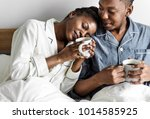 a couple having coffee in bed   Shutterstock . vector #1014585925