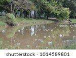 illegal dumped household... | Shutterstock . vector #1014589801