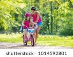 child riding bike. kid on... | Shutterstock . vector #1014592801