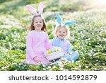 easter egg hunt in spring... | Shutterstock . vector #1014592879