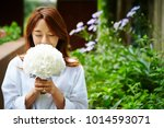 korean woman holding flower...   Shutterstock . vector #1014593071