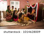 indian  family performing... | Shutterstock . vector #1014628009