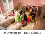 indian  family performing... | Shutterstock . vector #1014628039