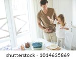 the family cooks in the kitchen | Shutterstock . vector #1014635869