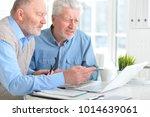 men working on laptop | Shutterstock . vector #1014639061