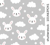 Stock vector cute rabbit seamless pattern animal background with clouds for kids 1014639241