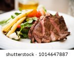 entrecote with green salad and... | Shutterstock . vector #1014647887