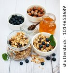 bowl with granola and... | Shutterstock . vector #1014653689