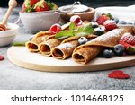 delicious tasty homemade crepes ... | Shutterstock . vector #1014668125