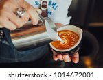 barista make coffee latte art...   Shutterstock . vector #1014672001