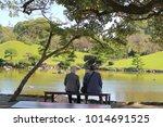 happy senior couple sitting in...   Shutterstock . vector #1014691525