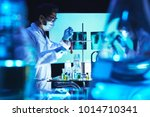 chemist adding reagent in test... | Shutterstock . vector #1014710341