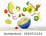 guacamole with flying corn... | Shutterstock . vector #1014711151