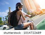 cheerful couple riding scooter...   Shutterstock . vector #1014722689