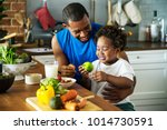 dad and son cooking together | Shutterstock . vector #1014730591