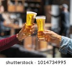 beer glasses raised in a toast. ...   Shutterstock . vector #1014734995