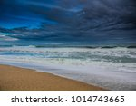 dramatic beach before rain in... | Shutterstock . vector #1014743665
