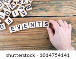 events. wooden letters on the... | Shutterstock . vector #1014754141