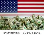 usa flag with us dollars | Shutterstock . vector #1014761641
