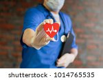 cardiologist give red heart... | Shutterstock . vector #1014765535