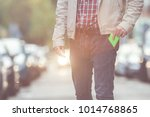 guy putting   taking out his... | Shutterstock . vector #1014768865