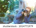 male tourist taking picture in... | Shutterstock . vector #1014771979