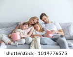 family fell a sleep while watch ... | Shutterstock . vector #1014776575