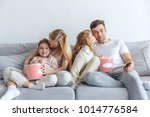 loving family watching movie on ... | Shutterstock . vector #1014776584